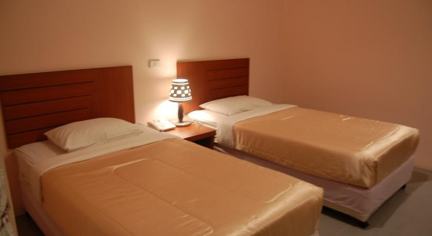 guest friendly hotels in Hua Hin - Baan Manthana Hotel - Bedroom